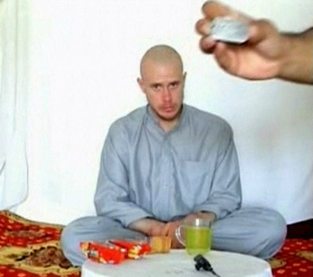 us-army-private-bowe-bergdahl-watches-as-one-of-his-captors-displays-his-identity-tag-to-the-camera-at-an-unknown-location-in-afghanistan-on-july-19-2009