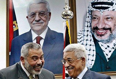 Abu-Mazen-and-Haniyeh-leering
