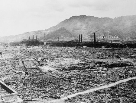 Original caption: 6/26/1946-Nagasaki, Japan: The leveled area you see here was once the industrial heart of the great city of Nagasaki.  A single atomic bomb, the third ever exploded, made it a wilderness.  In the background, the skeletal remains of the Mitsubishi steel and arms works survived for use as junk. Nagasaki, Japan