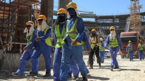 epa03956763 Foreign construction workers qleave a construction site in Doha, Qatar, 19 November 2013. The previous day, football's ruling body FIFA said it will continue to put pressure on 2022 World Cup hosts Qatar over the conditions of migrant workers in the country's construction sector, but issued no deadline for improvement. Britain-based rights group Amnesty International said 17 November that workers in the oil- and gas-rich Gulf state suffered difficulties including 'non-payment of wages, harsh and dangerous working conditions, and shocking standards of accommodation.' EPA/STR
