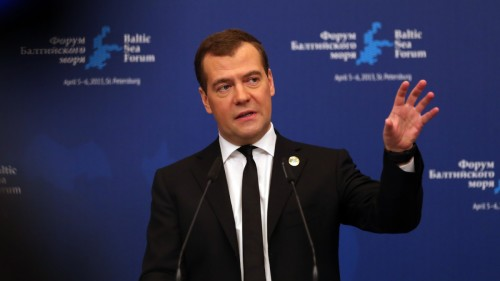epa03650559 Russian Prime Minister Dmitry Medvedev makes a hand gesture as he speaks at the plenary session of the Heads of the Baltic Sea states on environmental protection during the Baltic Sea Forum in St.Petersburg, Russia, 05 April 2013. EPA/ANATOLY MALTSEV